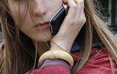 A Girl using Cell Phone Spying technology after installing Cell Phone Listening software